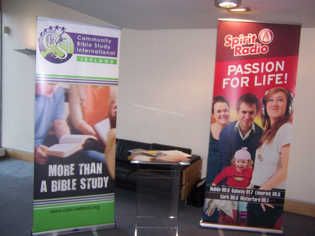 Our information table and banner sharing space with concert sponsor Spirit Radio.