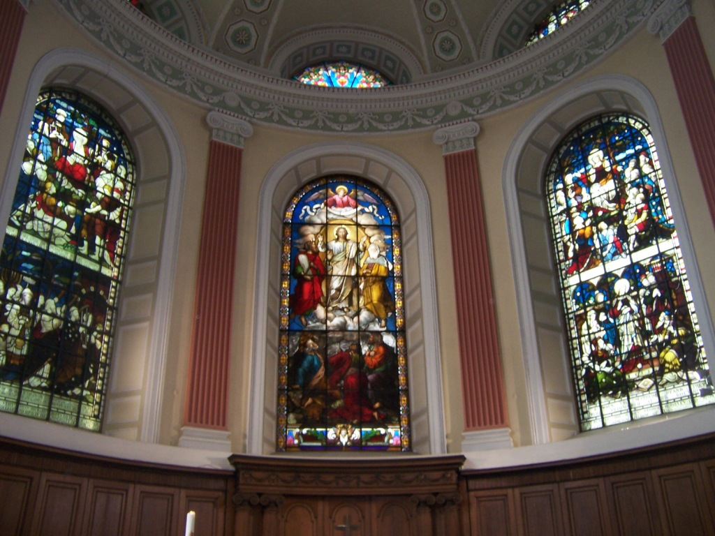 Stained glass windows above the altar